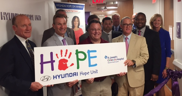 Tampa Area Hyundai Dealers stand in front of the new Hyundai Hope Unit at St. Josephs Children's Hospital.